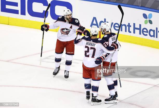 Ryan Murray of the Columbus Blue Jackets is congratulated by his teammates, Boone Jenner and Pierre-Luc Dubois after scoring a goal against the Tampa...
