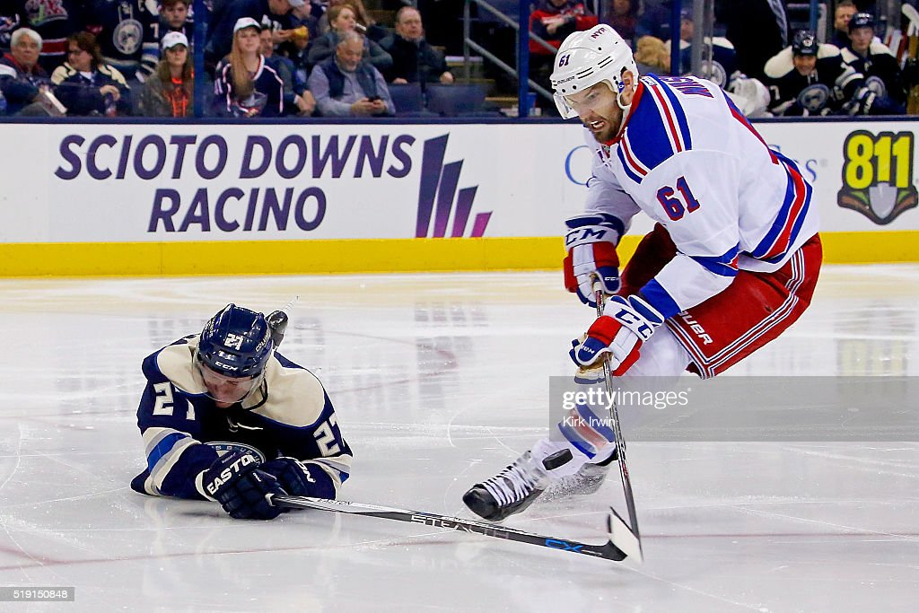 Ryan Murray #27 of the Columbus Blue Jackets knocks the puck away from Rick Nash #61 of the New York Rangers during the third period on April 4, 2016 at Nationwide Arena in Columbus, Ohio. New York defeated Columbus 4-2.