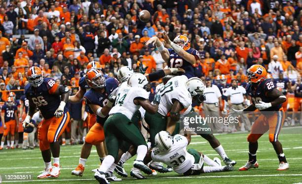 Ryan Nassib of the Syracuse Orange attempts to pass over the play against the South Florida Bulls during the game at the Carrier Dome on November 11...
