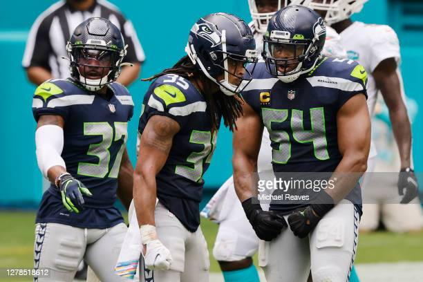 Ryan Neal and Bobby Wagner of the Seattle Seahawks react against the Miami Dolphins during the second half at Hard Rock Stadium on October 04, 2020...