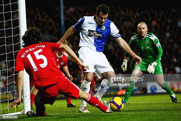Ryan Nelsen of Blackburn Rovers attempts to clear the ball from the feet of Liverpool's Yossi Benayoun during the Barclays Premier League match...