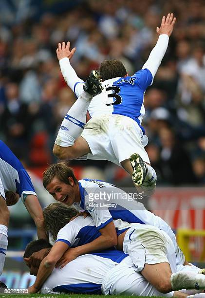 Ryan Nelsen of Blackburn Rovers is mobbed by his team mates after he scored his team's second goal during the Barclays Premier League match between...