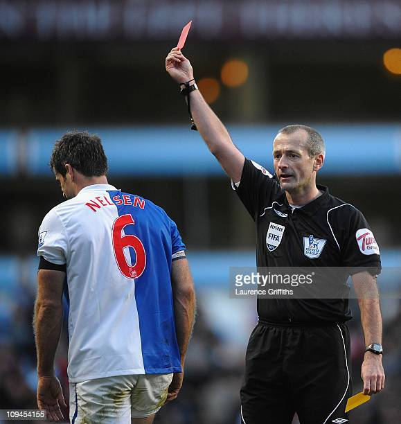 Ryan Nelsen of Blackburn Rovers receives a Red Card from Referee Martin Atkinson during the Barclays Premier League match between Aston Villa and...