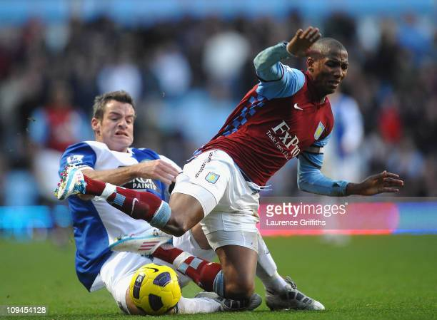 Ryan Nelsen of Blackburn takes out Ashley Young of Aston Villa to earn himself a Red Card during the Barclays Premier League match between Aston...