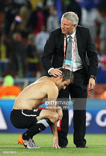 Ryan Nelsen of New Zealand is consoled by Ricki Herbert head coach of New Zealand after the 2010 FIFA World Cup South Africa Group F match between...