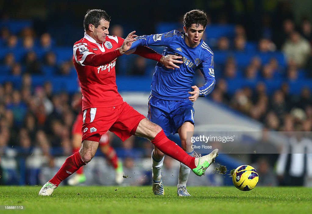 Ryan Nelsen of Queens Park Rangers tackles Oscar of Chelsea during the Barclays Premier League match between Chelsea and Queens Park Rangers at Stamford Bridge on January 2, 2013 in London, England.