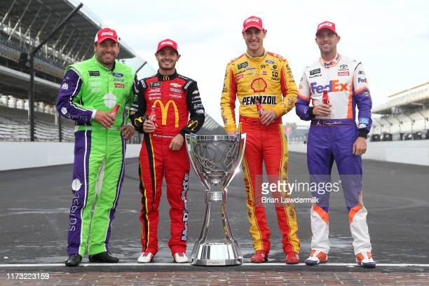 Ryan Newman driver of the Acorns Ford Kyle Larson driver of the McDonald's Chevrolet Joey Logano driver of the Shell Pennzoil Ford and Denny Hamlin...