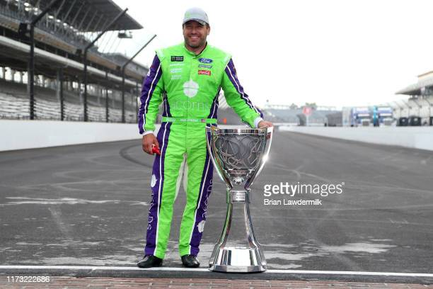 Ryan Newman driver of the Acorns Ford poses for a photo with the Monster Energy NASCAR Cup Series trophy to start the playoffs following the Monster...