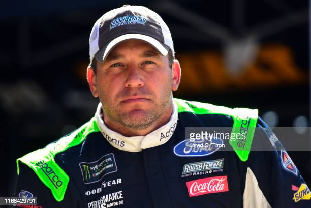 Ryan Newman driver of the Acronis Ford stands in the garage during practice for the Monster Energy NASCAR Cup Series Bass Pro Shops NRA Night Race at...