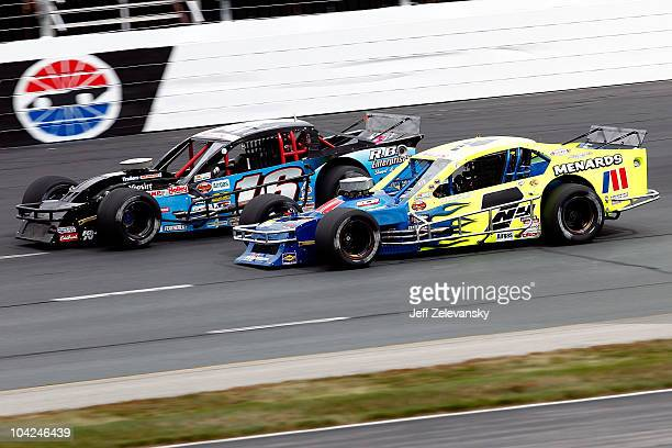 Ryan Newman driver of the Aggressive Hydraulics / Menards Chevrolet races side by each with Mike Stefanik driver of the Diversified Metals / RB...
