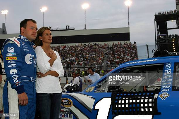 Ryan Newman driver of the alltel Dodge and his wife Krissie stand on the grid prior to the start of the NASCAR Sprint Cup Series Crown Royal Presents...