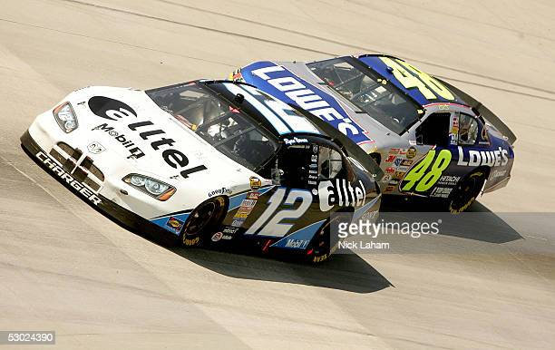 Ryan Newman driver of the alltel Dodge drives in front of Jimmie Johnson driver of the Lowe's Chevrolet during the NASCAR Nextel Cup MBNA RacePoints...