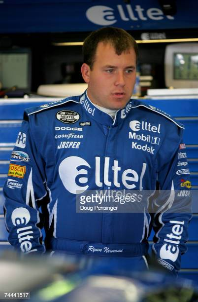 Ryan Newman driver of the alltel Dodge looks on in the garage during practice for the NASCAR Nextel Cup Series Pocono 500 at Pocono Raceway on June 8...