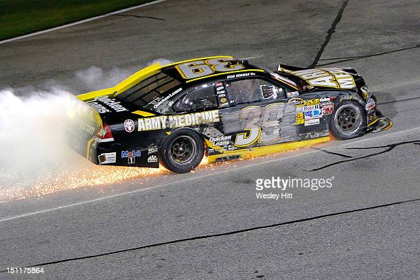 Ryan Newman driver of the Army Medicine Chevrolet drives his car towards the garage after he was knocked out of the race during the NASCAR Sprint Cup...