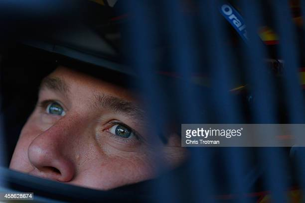 Ryan Newman driver of the Caterpillar Chevrolet sits in his car during practice for the NASCAR Sprint Cup Series Quicken Loans 500 at Phoenix...