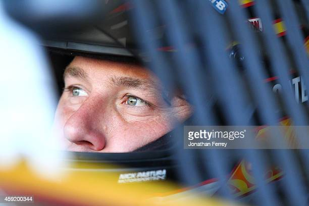 Ryan Newman driver of the Caterpillar Chevrolet sits in his car during practice for the NASCAR Sprint Cup Series Quicken Loans Race for Heroes 500 at...