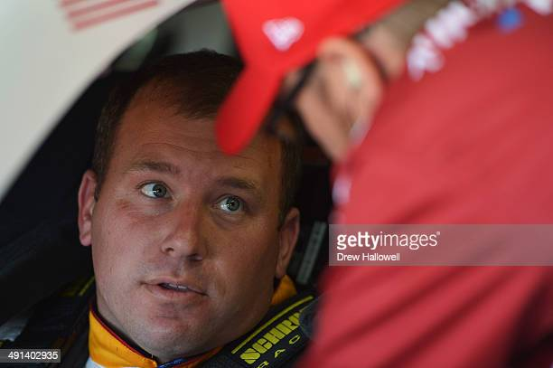 Ryan Newman driver of the CAT/Quicken Loans Chevrolet sits in his car inb the garage during practice for the NASCAR Sprint Cup Series Sprint AllStar...