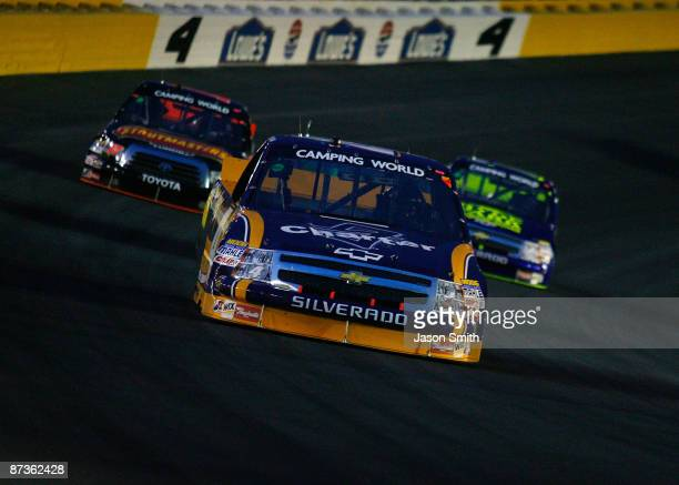 Ryan Newman driver of the Charter Communications Chevrolet leads a group of trucks during the NASCAR Camping World Series North Carolina Education...