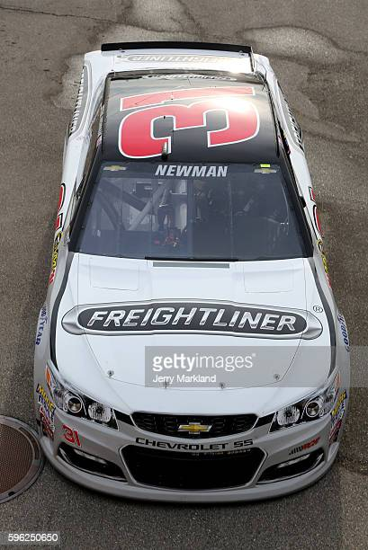 Ryan Newman driver of the Freightliner Chevrolet drives through the garage area during practice for the NASCAR Sprint Cup Series Pure Michigan 400 at...