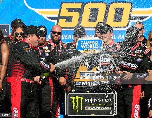 Ryan Newman driver of the Grainger Chevrolet celebrates in victory lane after winning the Monster Energy NASCAR Cup Series Camping World 500 at...