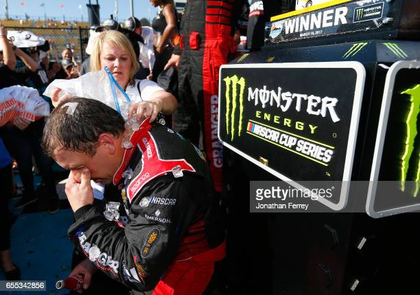 Ryan Newman driver of the Grainger Chevrolet gets cooled down with ice and water in victory lane after winning the Monster Energy NASCAR Cup Series...