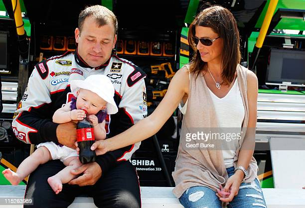 Ryan Newman driver of the Haas Automation Chevrolet his wife Krissie Newman and their daughter Brooklyn Sage Newman sits together prior to the NASCAR...