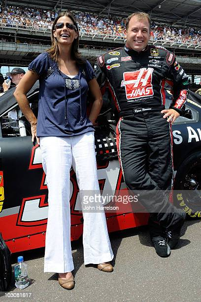Ryan Newman driver of the Haas Automation Chevrolet stands with his wife Krissie Newman on the grid before the NASCAR Sprint Cup Series Brickyard 400...