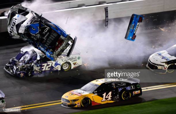 Ryan Newman driver of the Koch Industries Ford and Corey LaJoie driver of the RagingBullcom Ford crash during the last lap of the NASCAR Cup Series...