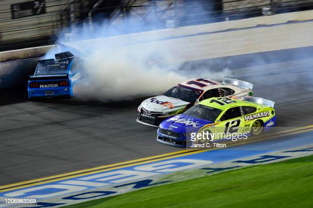 Ryan Newman, driver of the Koch Industries Ford, flips over as he crashes during the NASCAR Cup Series 62nd Annual Daytona 500 at Daytona...