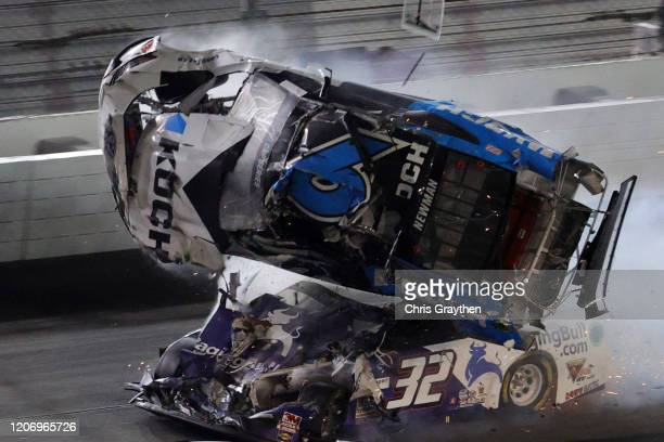 Ryan Newman driver of the Koch Industries Ford flips over as he crashes during the NASCAR Cup Series 62nd Annual Daytona 500 at Daytona International...