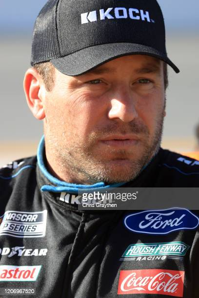 Ryan Newman driver of the Koch Industries Ford stands on the grid prior to the start of the NASCAR Cup Series 62nd Annual Daytona 500 at Daytona...