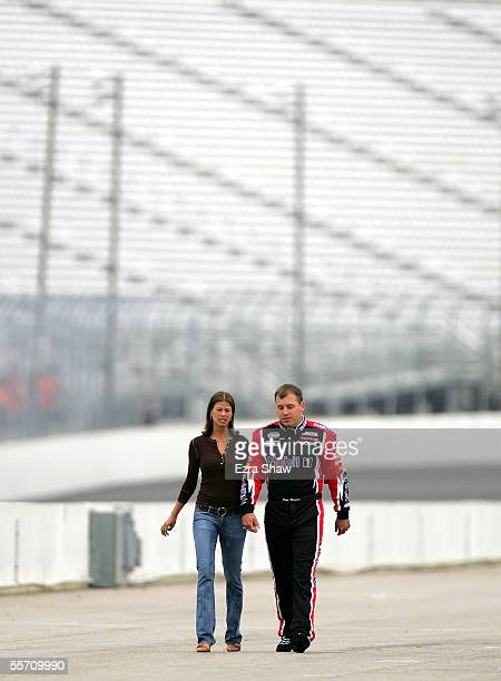Ryan Newman driver of the Mobil 1/Alltel Dodge walks with his wife Krissie during qualifying for the NASCAR Nextel Cup Sylvania 300 on September 17...