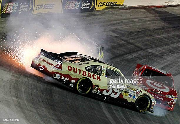 Ryan Newman driver of the Outback Steak House Chevrolet spins out in front of Dave Blaney driver of the SealWrap Chevrolet and Juan Pablo Montoya...