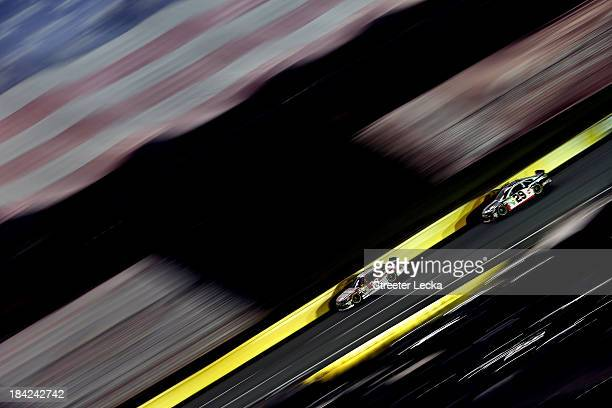 Ryan Newman driver of the Quicken Loans Chevrolet leads Kevin Harvick driver of the Jimmy John's Chevrolet during the NASCAR Sprint Cup Series Bank...