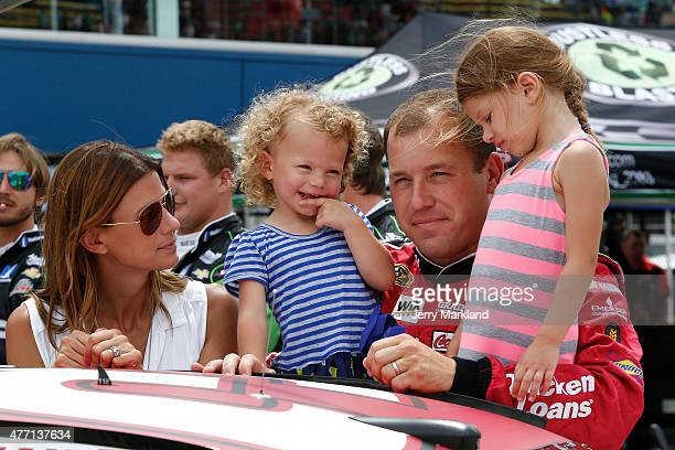 Ryan Newman driver of the Quicken Loans Chevrolet stands on the grid with his wife Krissie and daughters Brooklyn and Ashlyn prior to the NASCAR...