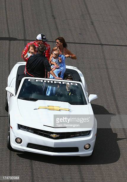 Ryan Newman driver of the Quicken Loans/The Smurfs Chevrolet arrives on the frontstretch with wife Krissie and daughters Brooklyn Sage and Ashlyn...