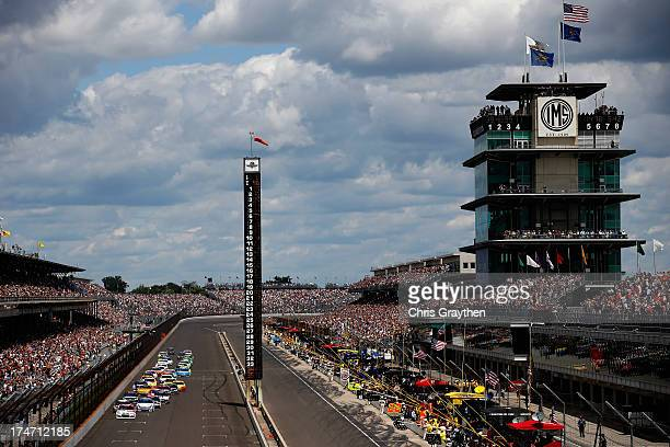 Ryan Newman driver of the Quicken Loans/The Smurfs Chevrolet leads the field to start the NASCAR Sprint Cup Series Samuel Deeds 400 At The Brickyard...