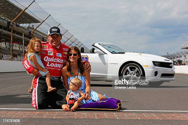 Ryan Newman driver of the Quicken Loans/The Smurfs Chevrolet celebrates with wife Krissie and daughters Brooklyn Sage and Ashlyn Olivia after winning...