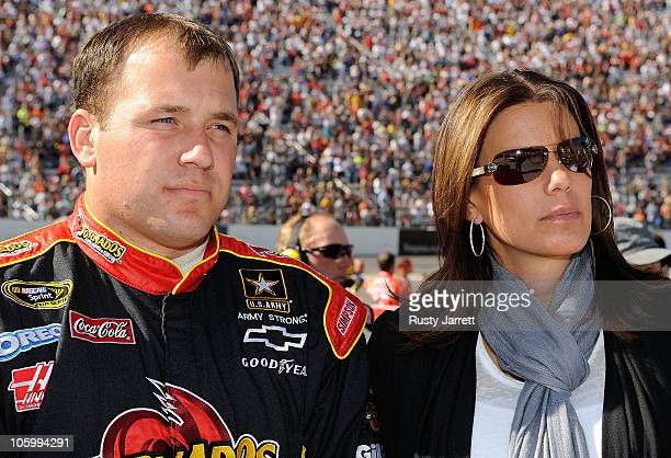 Ryan Newman driver of the Tornados Chevrolet stands with his wife Krissie on the grid prior to the NASCAR Sprint Cup Series TUMS Fast Relief 500 at...