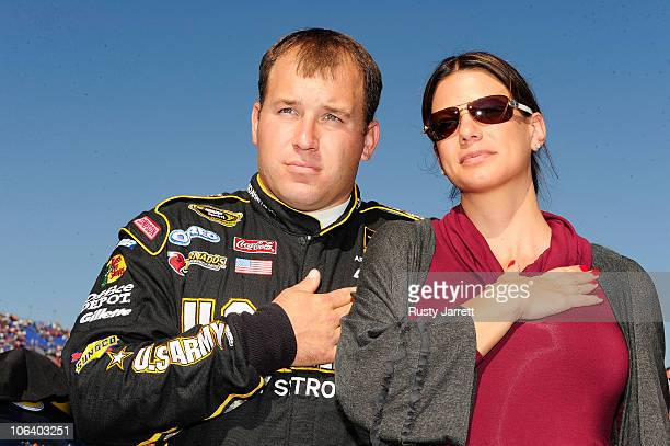 Ryan Newman driver of the US Army Chevrolet and his wife Krissie stand on the grid prior to the NASCAR Sprint Cup Series AMP Energy Juice 500 at...