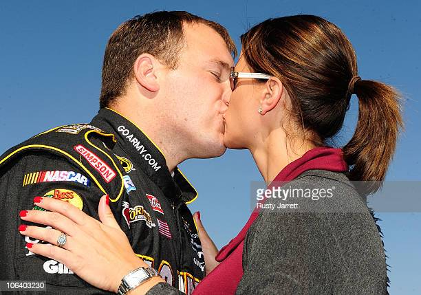 Ryan Newman driver of the US Army Chevrolet kisses his wife Krissie on the grid prior to the NASCAR Sprint Cup Series AMP Energy Juice 500 at...