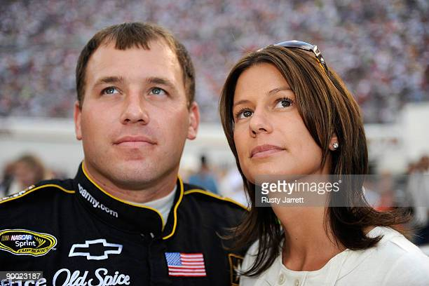 Ryan Newman driver of the US Army Chevrolet watches the pre race show with his wife Krissie prior to the start of the NASCAR Sprint Cup Series...