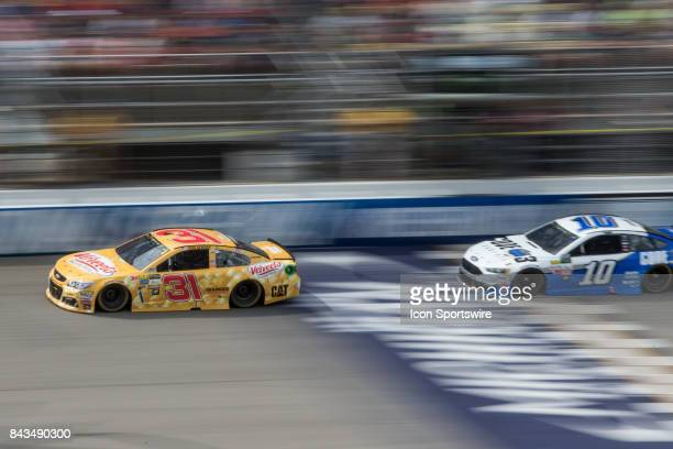 Ryan Newman driver of the Velveeta Shells Cheese Chevrolet races against Danica Patrick driver of the Code 3 Associates Ford during the Monster...