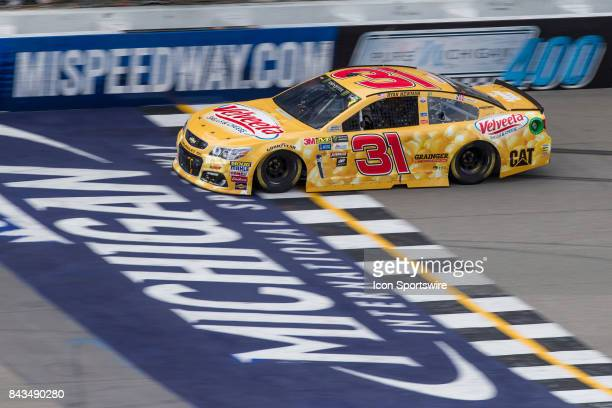 Ryan Newman driver of the Velveeta Shells Cheese Chevrolet races during the Monster Energy NASCAR Cup Series Pure Michigan 400 race on August 13 2017...