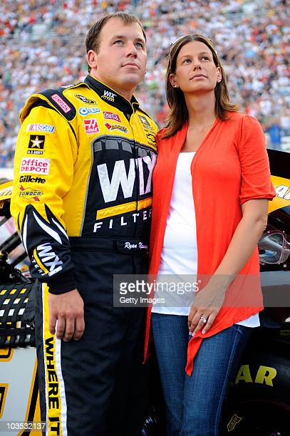 Ryan Newman driver of the Wix Filters Chevrolet stands with his wife Krissie on the grid prior to the NASCAR Sprint Cup Series IRWIN Tools Night Race...