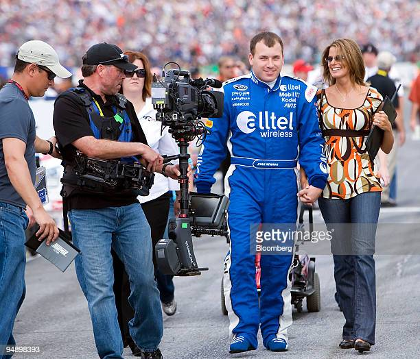 Ryan Newman of Team Penske walks with his wife Krissie before the start of the 50th running of the Daytona 500 in Daytona Beach Florida US on Sunday...