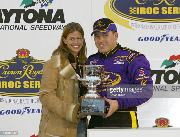 Ryan Newman with his wife Krissie hold the trophy for winning the Crown Royal IROC Series Race One at Daytona International Speedway February 13 2004