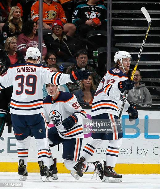 Ryan NugentHopkins Alex Chiasson and Connor McDavid of the Edmonton Oilers celebrate NugentHopkins' goal in the third period during the game against...