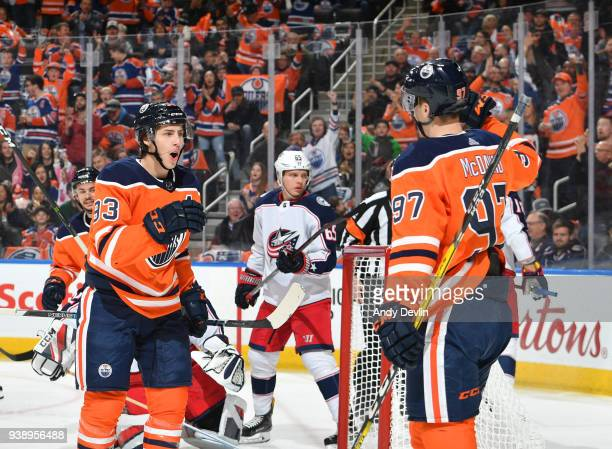 Ryan NugentHopkins and Connor McDavid of the Edmonton Oilers celebrate after goal during the game against the Columbus Blue Jackets on March 27 2018...