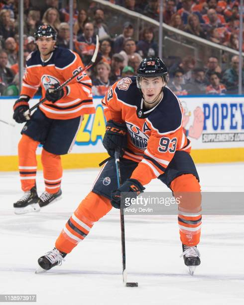 Ryan NugentHopkins and Darnell Nurse of the Edmonton Oilers skate against the Dallas Stars on March 28 2019 at Rogers Place in Edmonton Alberta Canada